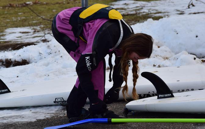 Christian gearing up with her Kokatat cold water paddling gear